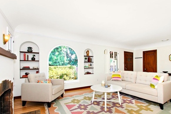 Living with original wood floors, picture window and niches